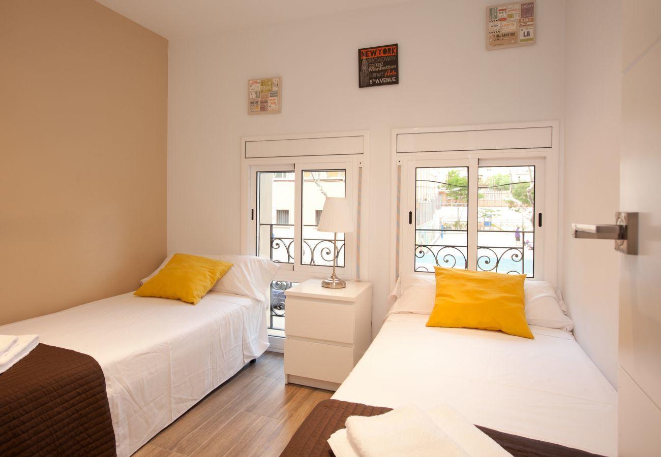 Camera doppia con 2 letti singoli in appartamento con 2 camere da letto vicino alla Sagrada Familia di Barcellona