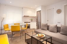living room with american kitchen of apartment in Barcelona