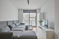 bright living room of 3-bedroom apartment and balcony