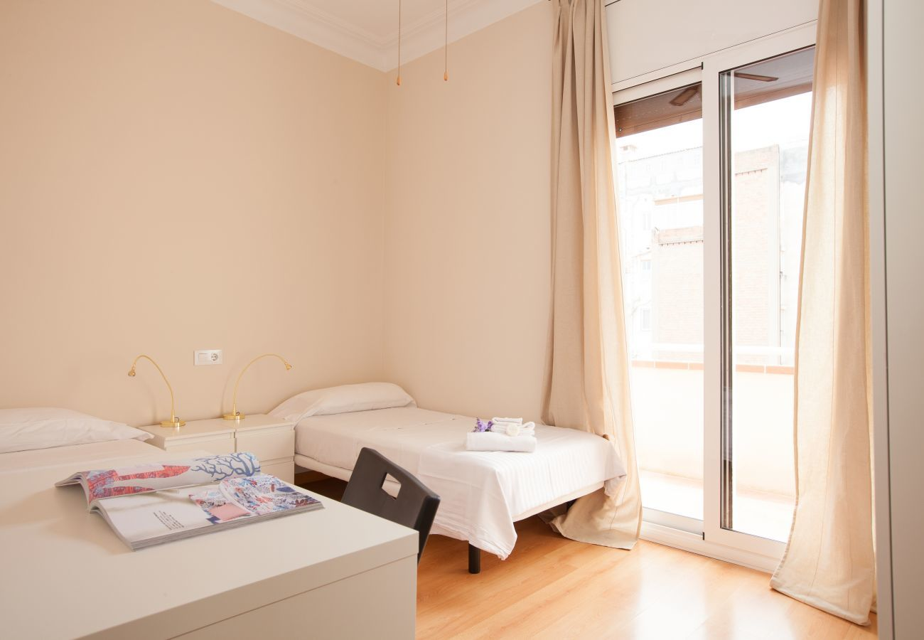 bedroom of apartment in Vallcarca with views to the mountains