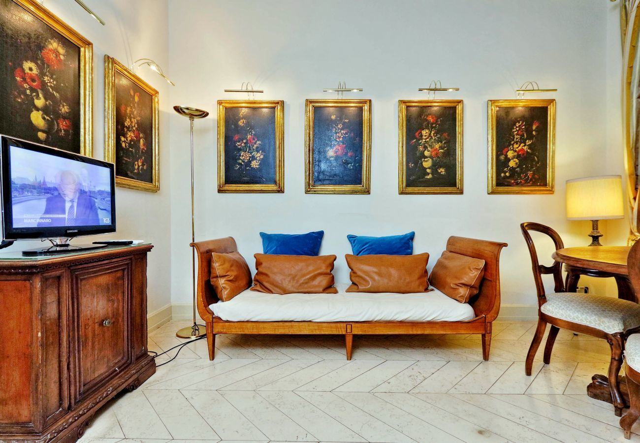 BOCCACCIO - living room with classic furniture: sofa with two seats, TV cabinet with television, dining table chairs, lamp and paintings
